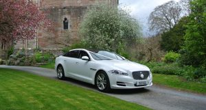 Modern wedding transport - Jaguar XJL (2 available)